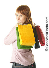Redhead girl with colored bags