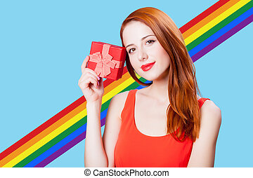 Redhead girl with gif box on blue background