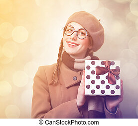 Redhead girl with gift box