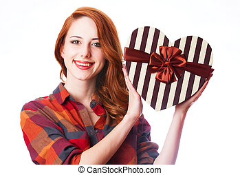 Redhead girl with gift.