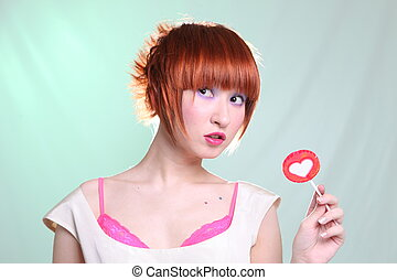 redhead girl with lollipop heart
