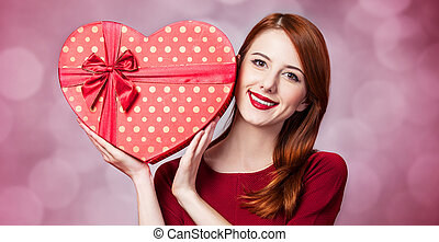 Redhead girl with shape heart box