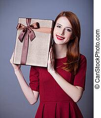 Redhead girl with shape heart box