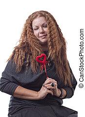 Redhead girl's holding heart