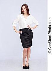 Redhead in black skirt