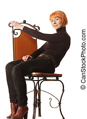 Redhead in casual sitting on chair