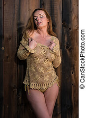 Redhead in gold - Beautiful tall redhead in a gold fishnet...