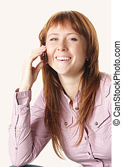 Redhead in pink shirt with mobile