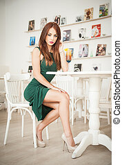 Redhead in restaurant with juice