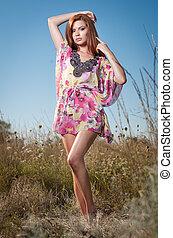 Redhead in wild flowers field