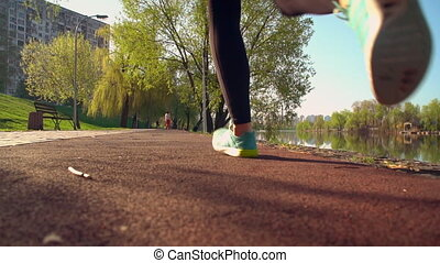 redhead jogger with ponytail trains outdoor - slow motion...