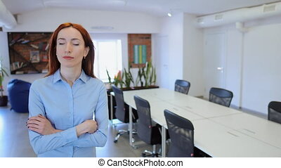 Redhead lady goes out of the workspace - Woman walking...