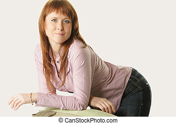 Redhead leaning on chair back