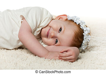 Redhead little girl on the carpet