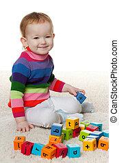 Redhead little girl with blocks