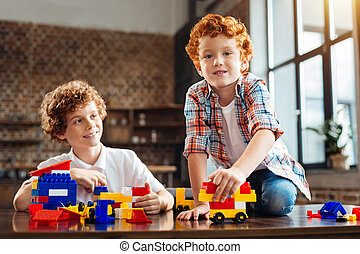 Redhead little kid playing with his older brother