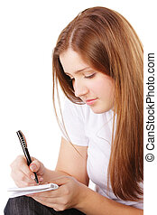 Redhead makes notes sideview