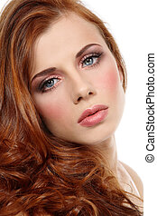 Portrait of young fresh beautiful redhead girl over white background