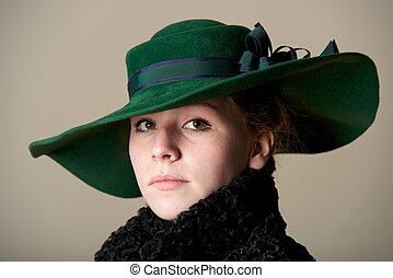 Redhead serious in green hat and black coat