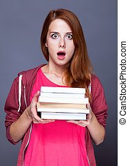 Redhead student with books