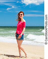 Redhead teen girl on the beach
