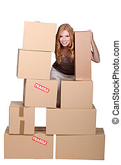 redhead woman and cardboard boxes