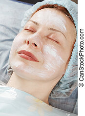 Redhead woman before face massage