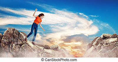 Redhead woman falling down between hills on cliff.