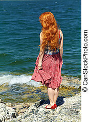 redhead woman in a dress