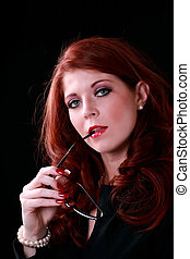 Redhead woman in business outfit glasses in mouth