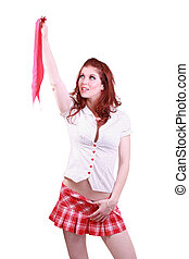 Redhead woman in schoolgirl outfit holding tie