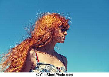 redhead woman in sunglasses