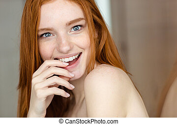 Redhead woman looking at camera - Portrait of a cheerful...