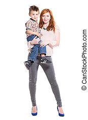 Redhead woman posing with a little boy