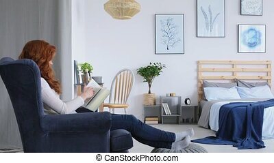 Redhead woman reading in bedroom movie - Redhead woman...