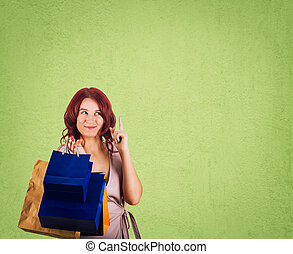 shopaholic - Redhead woman shopaholic trying to pay...
