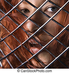 Redhead woman. - Pretty redhead young woman face behind...