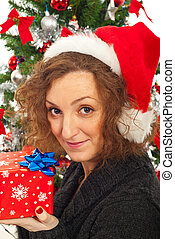 Redhead woman with Christmas gift