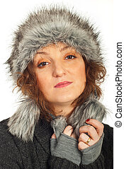 Redhead woman with fur hat