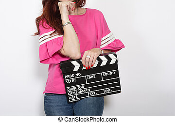 Redhead woman with movie board isolated on white background