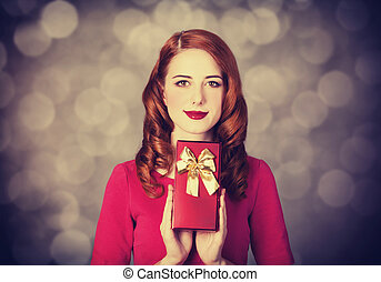 Redhead women with gift.