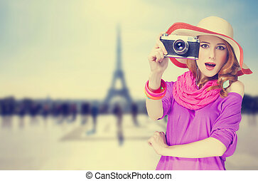 Redhead women with scarf and vintage camera on Parisian...