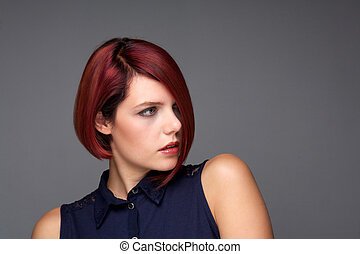 Redhead young woman with modern hairstyle