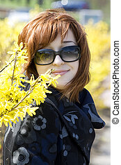Redheaded girl in the sunlight