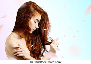 Redheaded woman over fresh blue background with swirl petals.