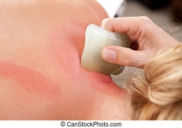 Redness During Gua Sha - Detail showing redness on skin...