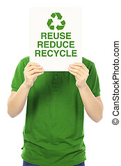 Reduce, Reuse, and Recycle - A young man holding a sign with...