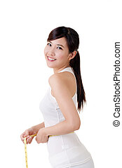 reduce weight - Asian woman measuring herself with measure ...