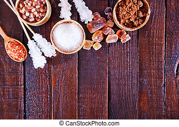 sugar - reed and white sugar on the wooden table