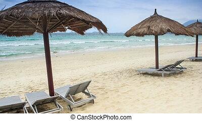 Reed Beach Umbrellas Chaise-longues on Sea Beach